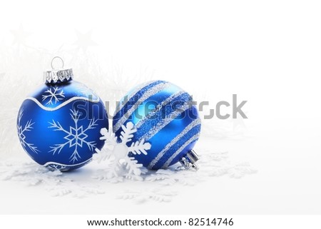 Blue Christmas balls with snow ornament - stock photo