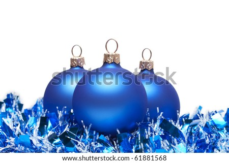 blue christmas balls with tinsel isolated on white - stock photo