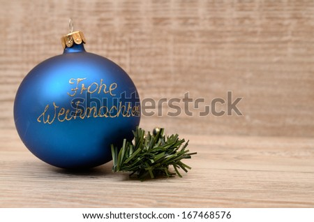 Blue Christmas bauble on a wooden background - stock photo