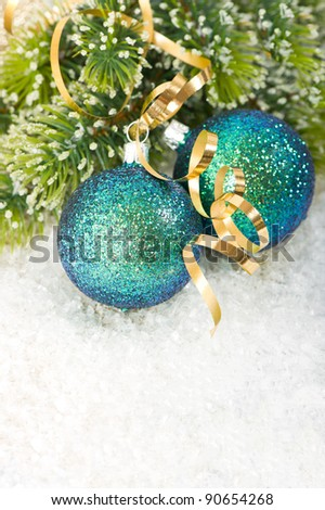 blue christmas bauble with christmas tree branch in snow decoration - stock photo