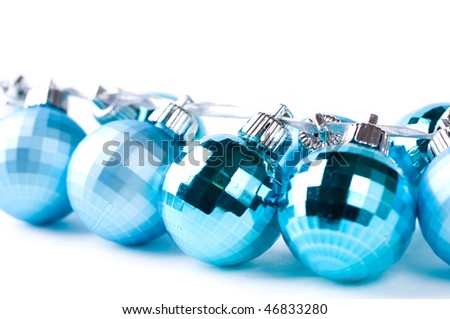 Blue Christmas baubles with silver ribbon isolated