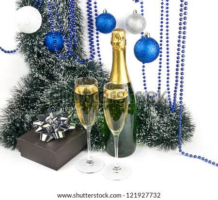 Blue Christmas composition with champagne and present