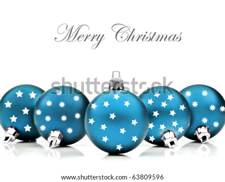 Blue christmas decoration baubles on a white background with space for text - stock photo