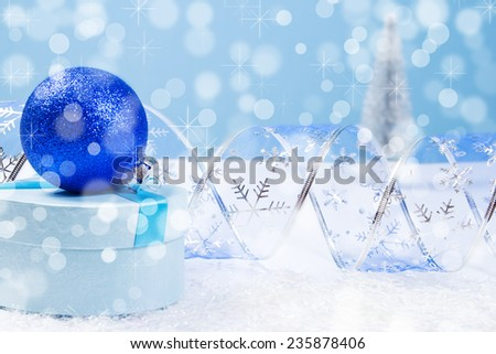 Blue Christmas gift box with bokeh background and copyspace for text - stock photo