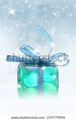 Blue christmas gift on glitter shiny background with stars. - stock photo