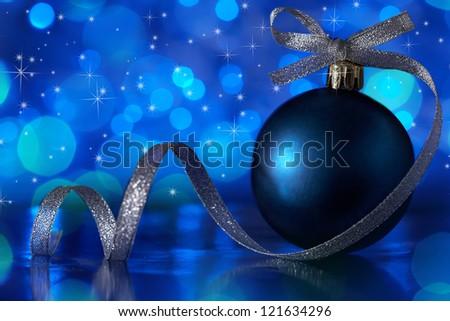 Blue christmas ornament with tape over illuminates - stock photo