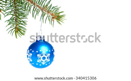 blue christmas tree ball hanging from spruce isolated on white background