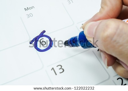 Blue circle. Mark on the calendar at 6. - stock photo