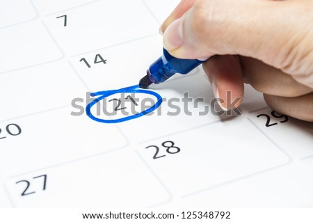 Blue circle. Mark on the calendar at 21. - stock photo