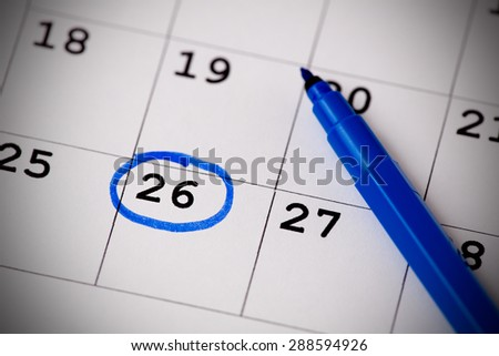 Blue circle. Mark on the calendar at 26. - stock photo