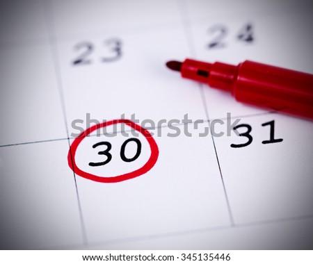 Blue circle. Mark on the calendar at 30. - stock photo