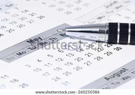 Blue circle marked on a calendar, reminder about an important date, shallow depth of field - stock photo