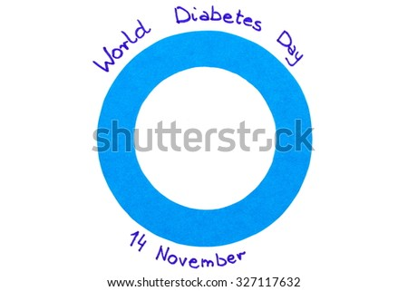 Blue circle of paper and date written on white background, symbol of world diabetes day - stock photo