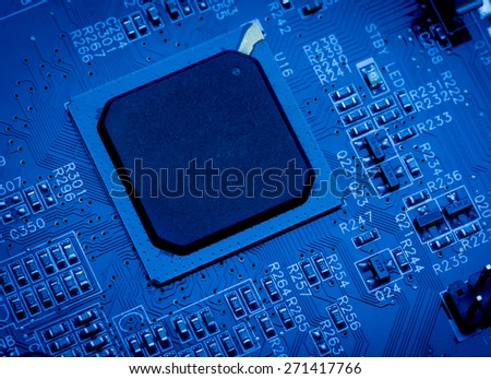 blue circuit board background of computer motherboard close up - stock photo