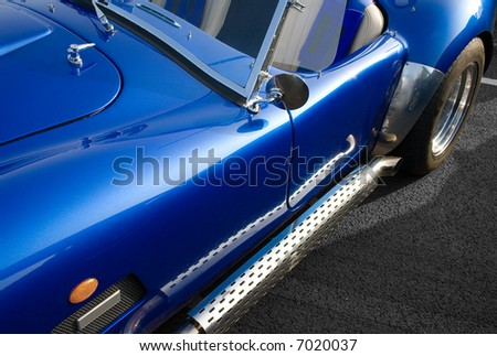Blue classic American muscle car with chrome side exhaust - stock photo
