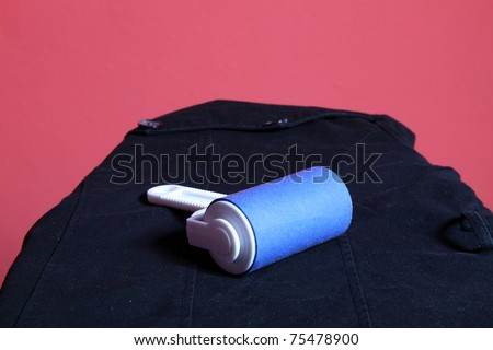 blue cleaner dust with lint roller red background