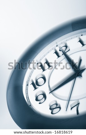 blue clock shaking. time concept - stock photo