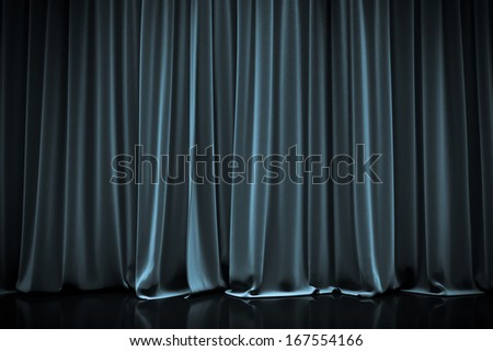 blue closed curtain in a theater - stock photo