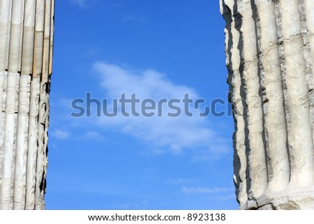 Blue clouded sky between two ancient Greek columns in Athens, Greece