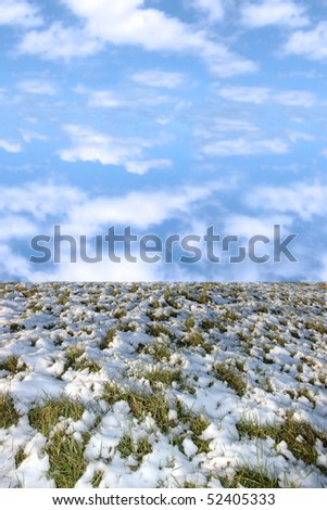 blue cloudy sky over snow covered green grass in ireland