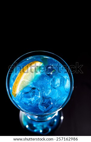 Blue cocktail on a black background - stock photo