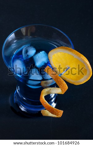 Blue cocktail on black background - stock photo