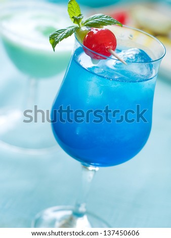 Blue cocktail with ice, selective focus - stock photo