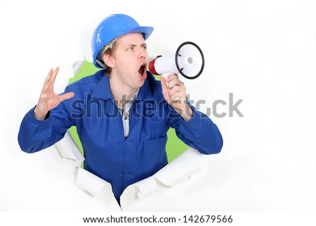 blue collar shouting in loudspeaker - stock photo