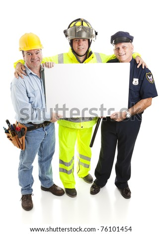 Blue collar workers - firefighter, policeman, and construction worker - all holding a blank sign, ready for your text.  Full body isolated. - stock photo