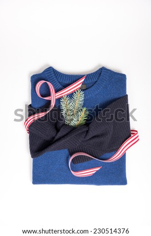 Blue Color-Block Sweater on White Background with Christmas Ribbon - stock photo