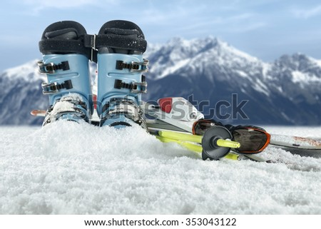 blue color of shoes and skis time  - stock photo