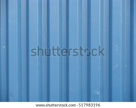 Blue color painted corrugated iron sheet close up for background.