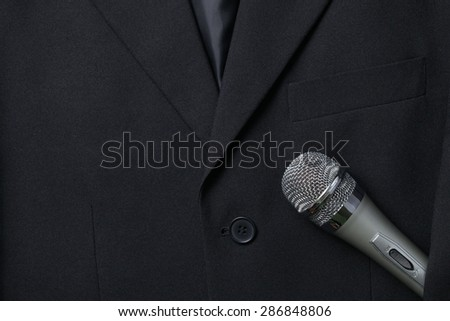 Blue color suit and microphone represent the business concept related idea.