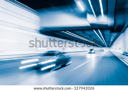 Blue color tunnel car driving motion blur - stock photo