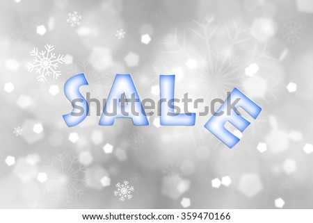 Blue color winter Sale caption on abstract blurred silver color bokeh with snowflake background. Beautiful freshness seasonal winter sale copy space background.