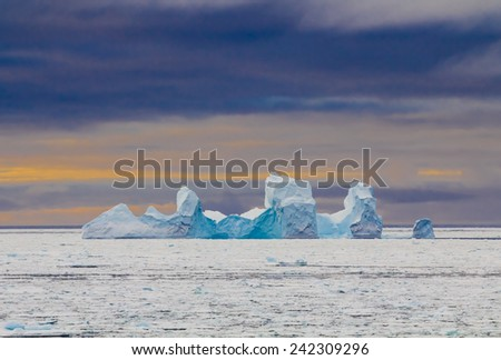 Blue colored iceberg during sunset in Antarctica (Weddell Sea)