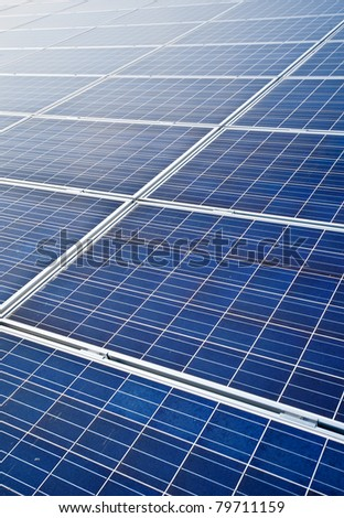 blue colored, photovoltaic solar modules for producing electricity, green energy concept texture - stock photo