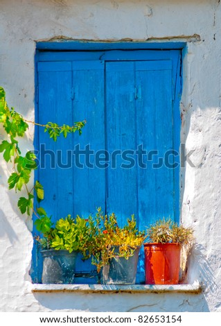 Blue colored window from  an old Greek house in Skiathos - stock photo