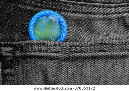 blue condom pack in back pocket jeans,abortion concept. - stock photo