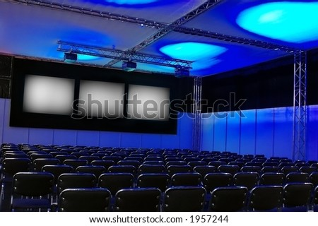 blue conference room with chairs - stock photo