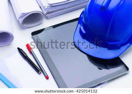 Blue construction helmet notepad, Blue print, pen on table architectural project - stock photo