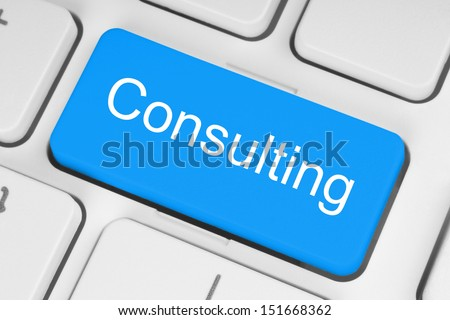 Blue consulting button on white keyboard