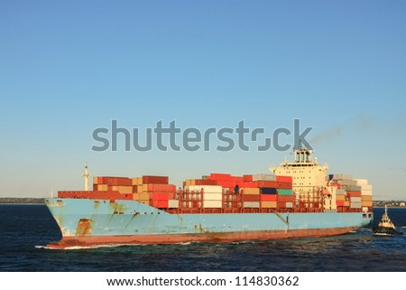Blue container cargo ship at sea