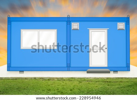 Blue container house on concrete pedestal with sky background. - stock photo