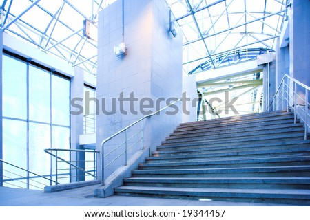 Blue corridor, people mooving near staircase