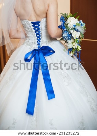 blue corset bride and the bridal bouquet. - stock photo