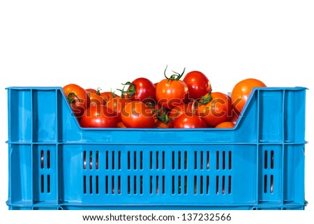 Blue crate with fresh tomatoes isolated on a white background - stock photo