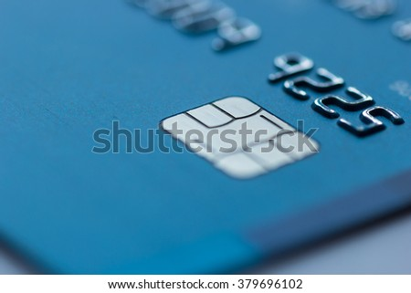 Blue credit card chip blurred - stock photo