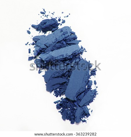 blue crumbled eyeshadow on white background - stock photo