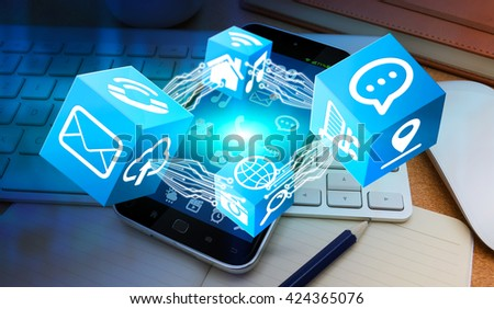Blue cubes frying over modern mobile phone in office '3D rendering'